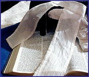 A traveling preacher's portmanteau with his Bible, clean shirt and lappets, that symbolize the two tablets of the Law.